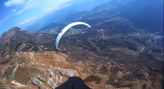 """Paragliding in Molveno Lake"""