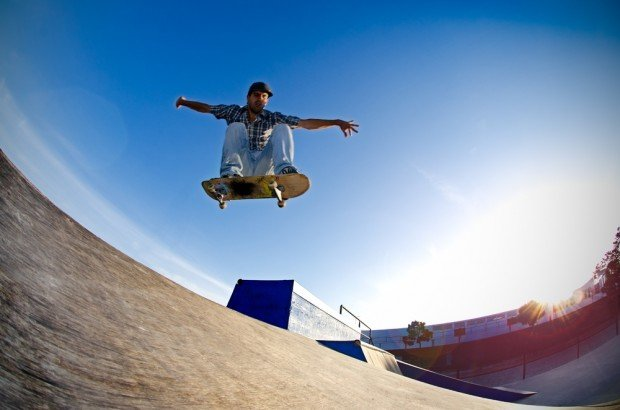 """Skateboarder jumping"""