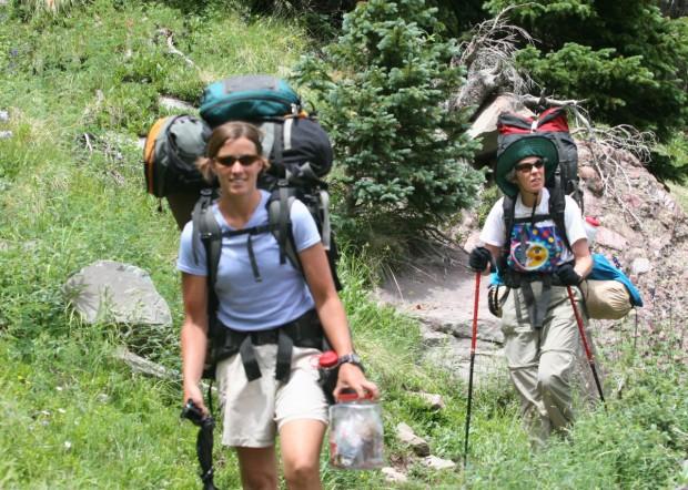 """Backpackers walking in the wilderness"""