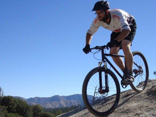 """Mountain Biker Freeriding at Mount Shasta"""