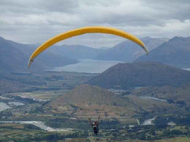"""Paragliding off Coronet Peak"""