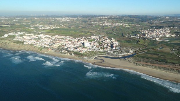 """Surfing at Praia da Areia Branca"""