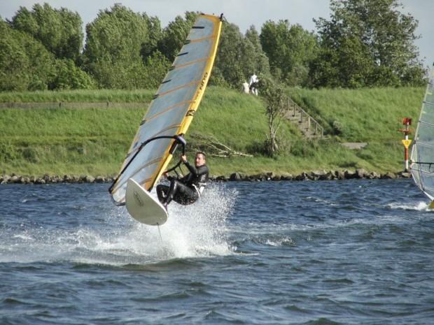 """Windsurfer jumps at Erlichsee"""