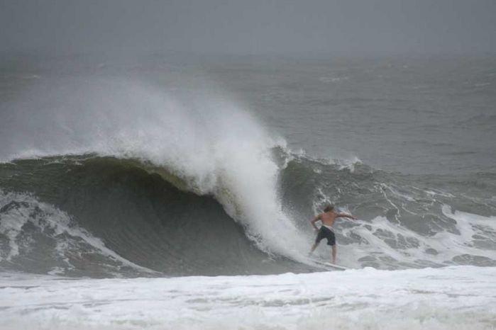 Surfing At Folly Beach
