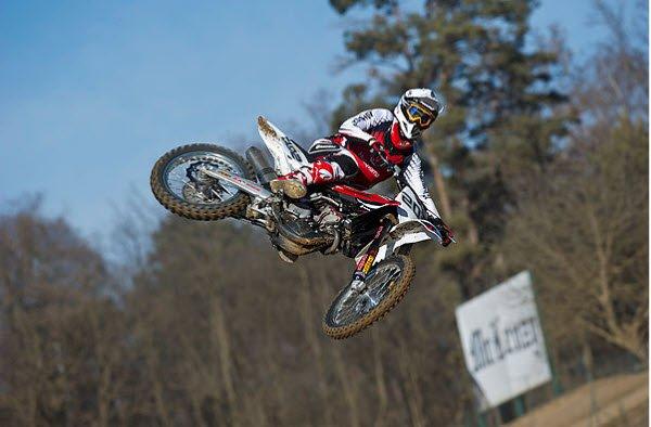 """""""Motocross rider jumping in Joliet Motorsports Park"""""""