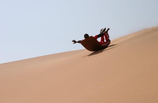 ''Sandboarding in Swakopmund''
